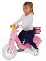 Růžové dřevěné dětské odrážedlo motorka